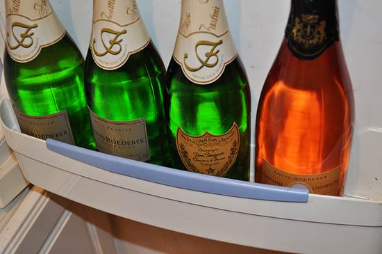 Bottles of Dom Perignon and Cristal in a Cooler